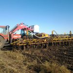 Casey planting sorghum