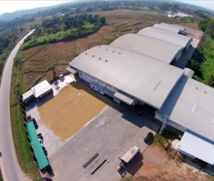 A drone captures an image of the rice processing facility