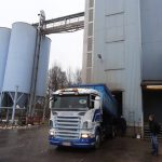 Truck delivers oats to the mill